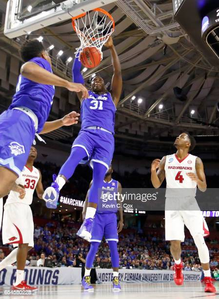 Angel Delgado of the Seton Hall Pirates dunks the ball against Daryl Macon of the Arkansas Razorbacks in the first round of the 2017 NCAA Men's...
