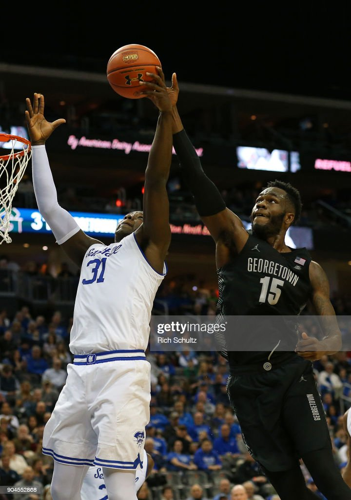Angel Delgado #31 of the Seton Hall Pirates fights off Jessie Govan #15 of the Georgetown Hoyas for a rebound during the first half of a game at Prudential Center on January 13, 2018 in Newark, New Jersey. Seton Hall defeated Georgetown 74-61.