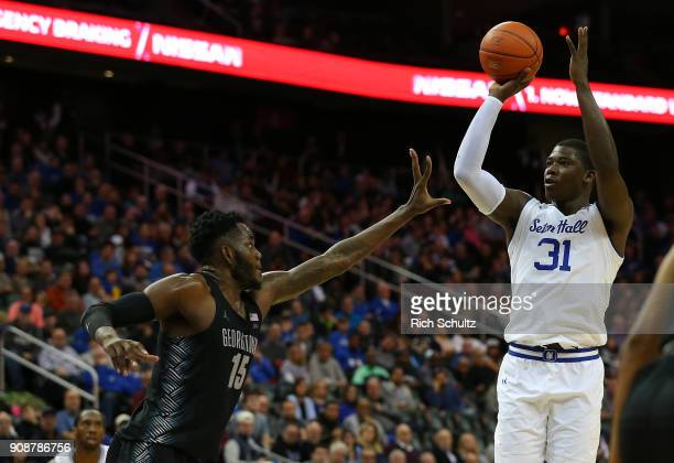 Angel Delgado of the Seton Hall Pirates in action against Jessie Govan of the Georgetown Hoyas during a game at Prudential Center on January 13 2018...