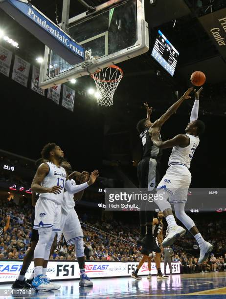 Angel Delgado of the Seton Hall Pirates in action against Rodney Bullock of the Providence Friars during the second half of a game at Prudential...