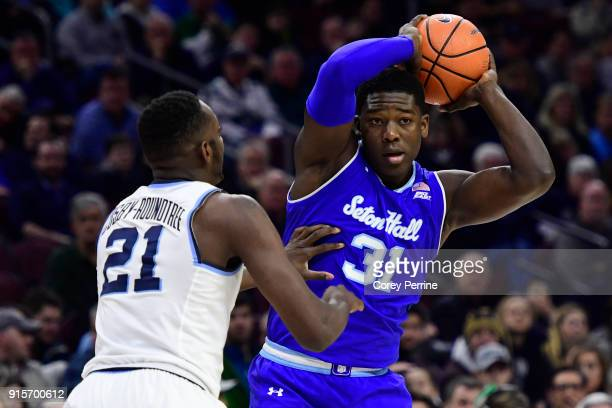 Angel Delgado of the Seton Hall Pirates looks to pass against Dhamir CosbyRoundtree of the Villanova Wildcats during the first half at the Wells...