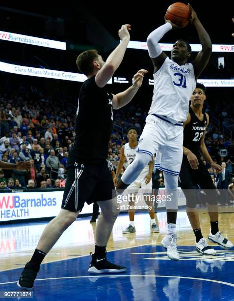 Angel Delgado of the Seton Hall Pirates puts up a shot in front of Sean O'Mara of the Xavier Musketeers during their game at Prudential Center on...
