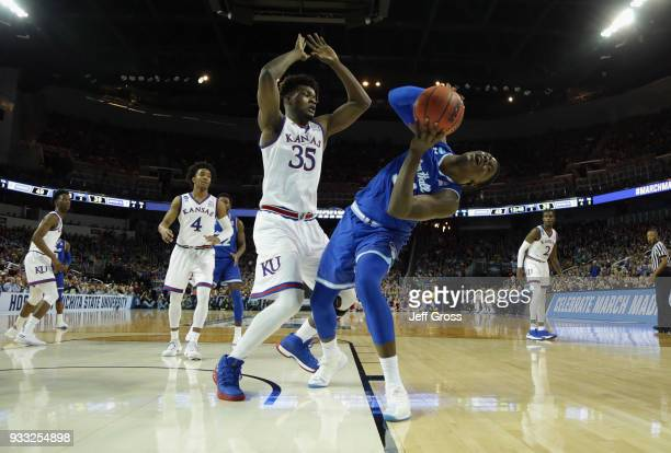 Angel Delgado of the Seton Hall Pirates reacts against Udoka Azubuike of the Kansas Jayhawks in the second half during the second round of the 2018...