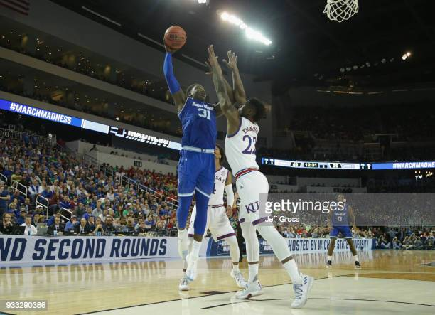 Angel Delgado of the Seton Hall Pirates shoots against Silvio De Sousa of the Kansas Jayhawks in the second half during the second round of the 2018...