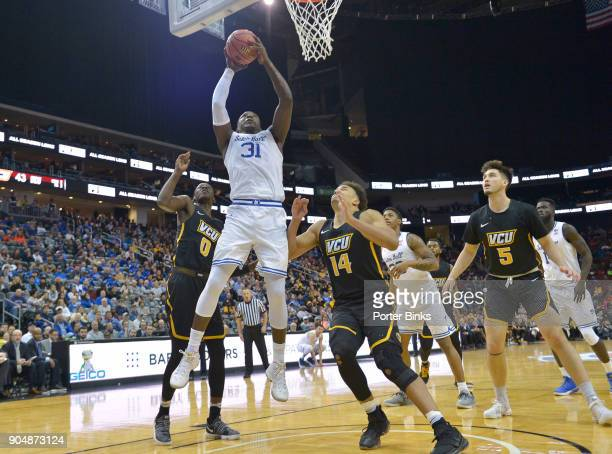Angel Delgado of the Seton Hall Pirates shoots against the Virginia Commonwealth Rams during the Never Forget Tribute Classic at the Prudential...