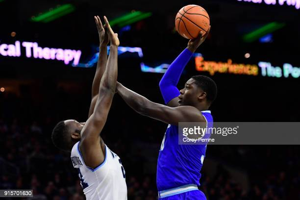Angel Delgado of the Seton Hall Pirates shoots the ball over Dhamir CosbyRoundtree of the Villanova Wildcats during the first half at the Wells Fargo...