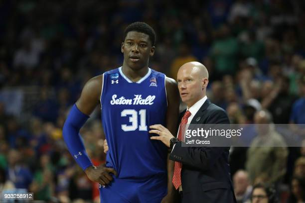 Angel Delgado of the Seton Hall Pirates talks with head coach Kevin Willard as they take on the Kansas Jayhawks in the second half during the second...