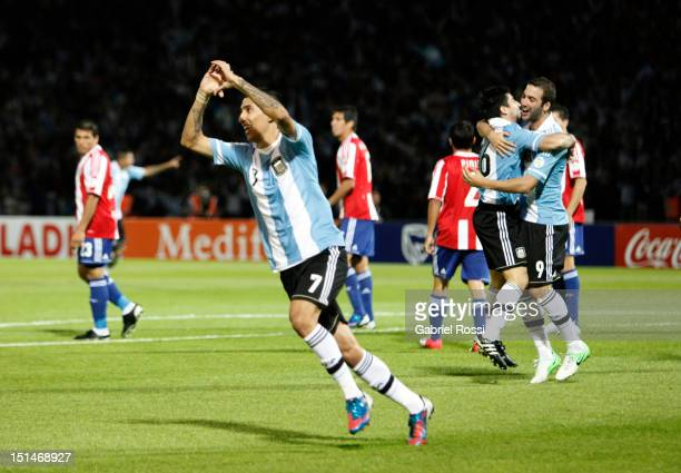 Angel Di Mari of Argentina celebrates a goal during a match between Argentina and Paraguay as part of the South American Qualifiers for the FIFA...