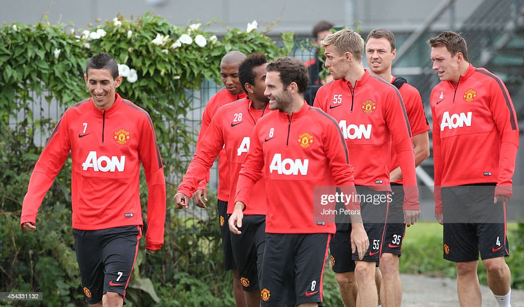 Angel di Maria and Juan Mata of Manchester United in action during a first team training session at Aon Training Complex on August 29, 2014 in Manchester, England.
