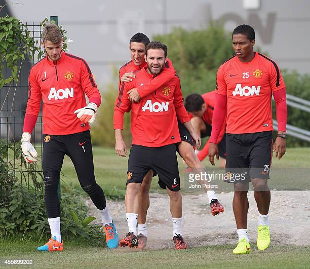 Angel di Maria and Juan Mata of Manchester United in action during a first team training session at Aon Training Complex on September 19 2014 in...