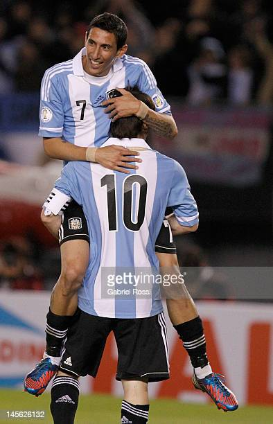 Angel Di Maria and Lionel Messi from Argentina celebrate a goal during a match between Argentina and Ecuador as part of the fifth round of the South...