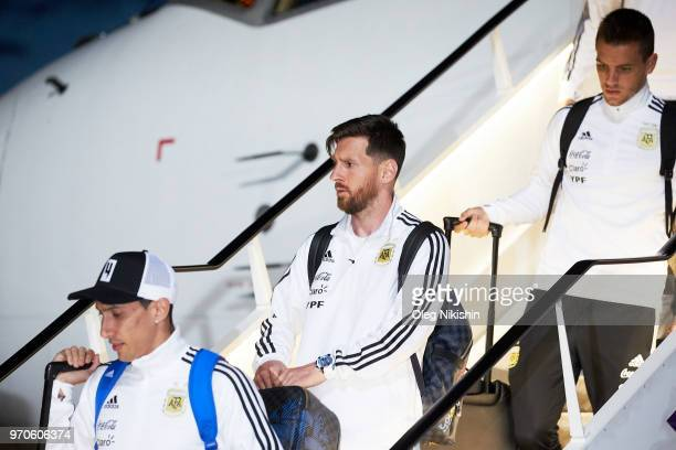 Angel Di Maria and Lionel Messi of the Argentina football team arrive to compete in the 2018 World Cup at Zhukovsky airport on June 9 2018 in Moscow...