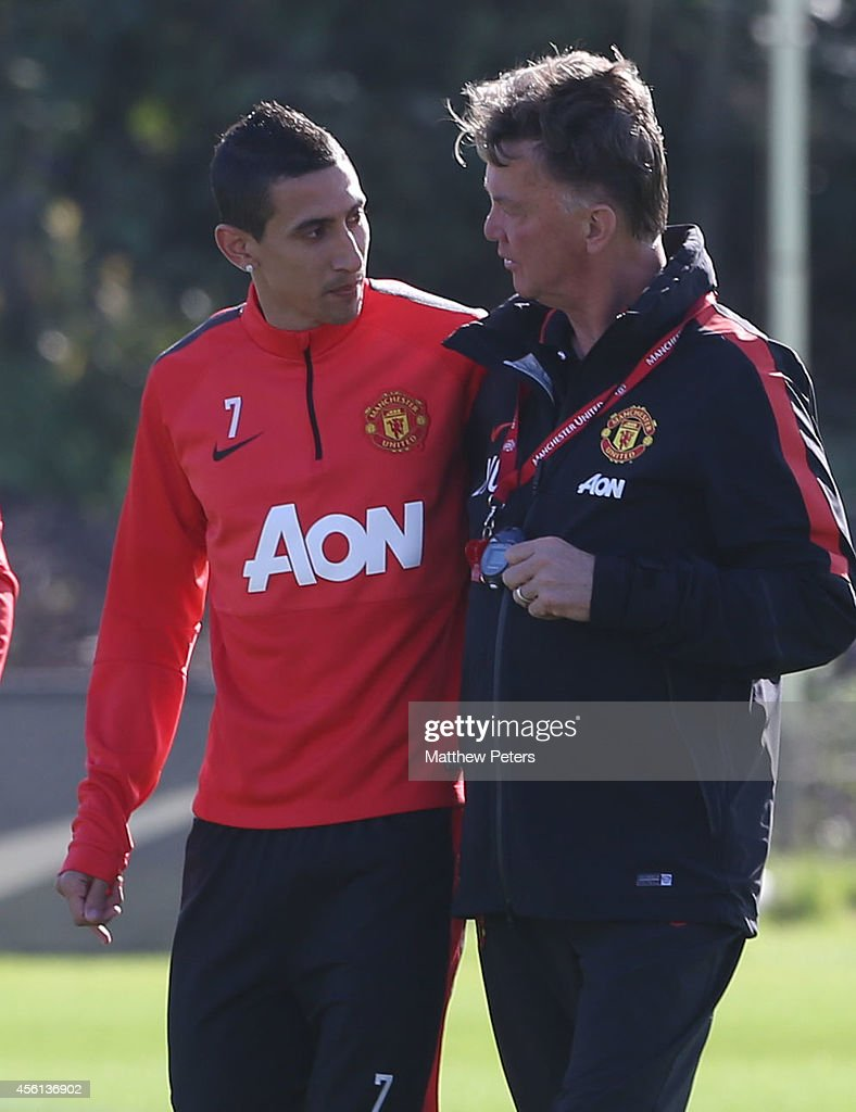 Angel di Maria and Manager Louis van Gaal of Manchester United in action during a first team training session at Aon Training Complex on September 26, 2014 in Manchester, England.