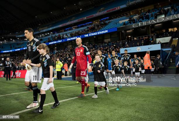 Angel Di Maria and Willy Caballero of Argentina come out for the start of the International Friendly match between Italy and Argentina at Etihad...