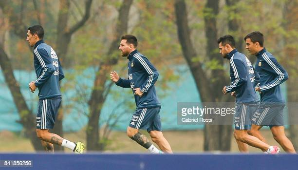 Angel Di Maria Lionel Messi and Paulo Dybala of Argentina warm up during a training session at 'Julio Humberto Grondona' training camp on September...