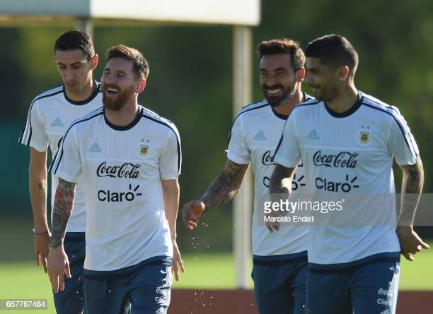 Angel Di Maria Lionel Messi Ezequiel Lavezzi and Ever Banega of Argentina warm up during a training session at Argentine Football Association 'Julio...