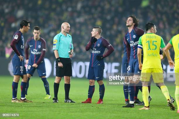 Angel Di Maria Marco Verratti of Paris Saint Germain and Tony Chapron referee during the Ligue 1 match between FC Nantes and Paris Saint Germain at...