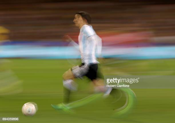 Angel Di Maria of Agrentina runs with the ball during the Brazil Global Tour match between Brazil and Argentina at Melbourne Cricket Ground on June 9...