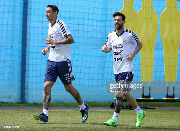 Angel Di Maria of Argentina and Lionel Messi of Argentina warm up during a training session at Stadium of Syroyezhkin sports school on June 27 2018...