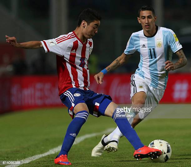 Angel Di Maria of Argentina and Miguel Almiron of Paraguay battle for the ball during a match between Argentina and Paraguay as part of FIFA 2018...