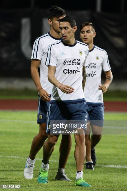 Angel Di Maria of Argentina and teammates warm up during a training session at Bishan Stadium on June 11 2017 in Singapore Argentina is scheduled to...