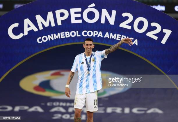 Angel Di Maria of Argentina celebrates after receiving the championship medal during the final of Copa America Brazil 2021 between Brazil and...