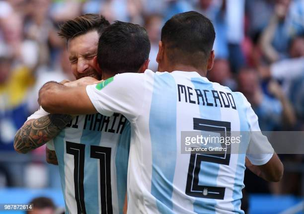 Angel Di Maria of Argentina celebrates scoring his side's first goal with team mates Lionel Messi and Gabriel Mercado during the 2018 FIFA World Cup...