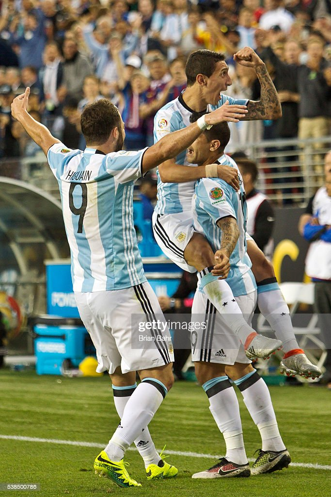 Angel Di Maria of Argentina celebrates with Ever Banega and Gonzalo Higuain after scoring the first goal against Chile in the second half during a group D match between Argentina and Chile at Levi's Stadium as part of Copa America Centenario US 2016 on June 06, 2016 in Santa Clara, California, US.