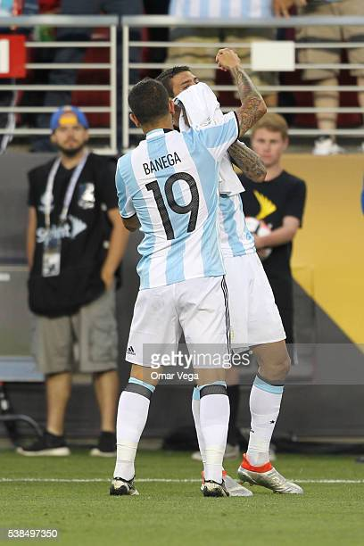 Angel Di Maria of Argentina celebrates with teammate Ever Banega after scoring the opening goal during a group D match between Argentina and Chile at...