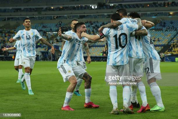 Angel Di Maria of Argentina celebrates with teammates after scoring the first goal of his team during the final of Copa America Brazil 2021 between...