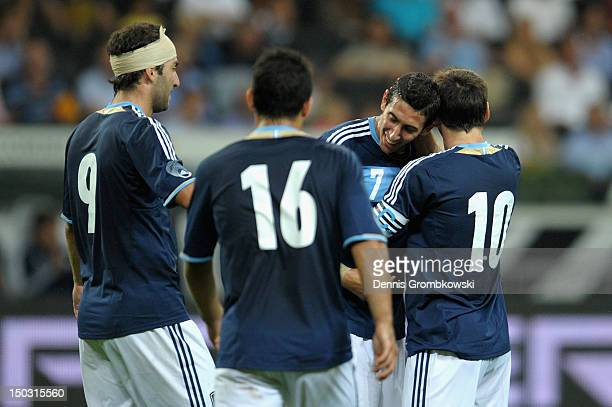 Angel di Maria of Argentina celebrates with teammates Lionel Messi Gonzalo Higuain and Sergio Aguero after scoring his team's third goal during the...