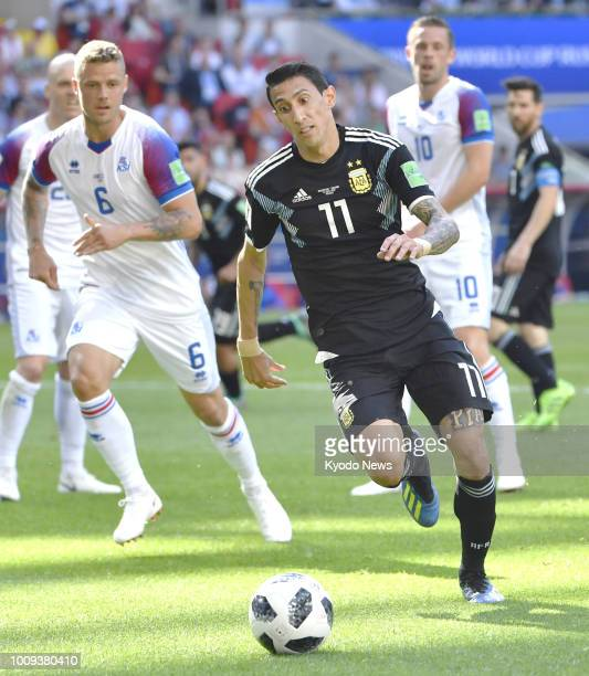 Angel Di Maria of Argentina dribbles the ball during the first half of a 11 draw with Iceland in a World Cup Group D match at Spartak Stadium in...
