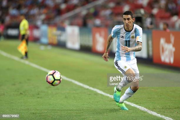 Angel Di Maria of Argentina dribbles the ball during the international friendly match between Argentina and Singapore at National Stadium on June 13...