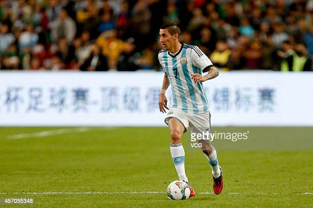 Angel Di Maria of Argentina drives the ball during a match between Argentina and Brazil as part of 2014 Super Clasico at Beijing National Stadium on...