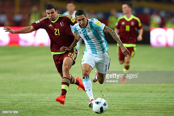 Angel Di Maria of Argentina fights for the ball with Alexander Gonzalez during a match between Venezuela and Argentina as part of FIFA 2018 World Cup...