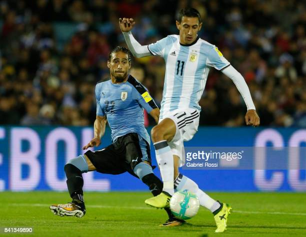 Angel Di Maria of Argentina fights for the ball with Martin Caceres of Uruguay during a match between Uruguay and Argentina as part of FIFA 2018...