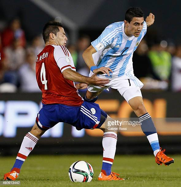 Angel Di Mar'ia of Argentina fights for the ball with Pablo Aguilar of Paraguay during a match between Paraguay and Argentina as part of FIFA 2018...