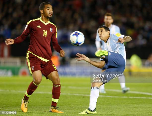Angel Di Maria of Argentina fights for the ball with Yangel Herrera of Venezuela during a match between Argentina and Venezuela as part of FIFA 2018...