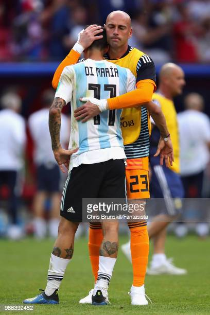 Angel Di Maria of Argentina hugs teammate Willy Caballero after the 2018 FIFA World Cup Russia Round of 16 match between France and Argentina at...