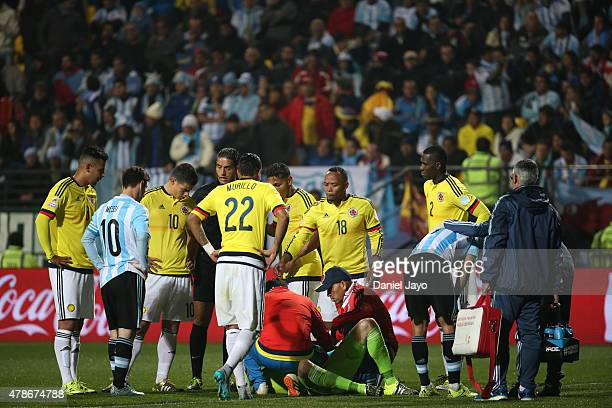 Angel di Maria of Argentina is assited by medical staff after being injuried during the 2015 Copa America Chile quarter final match between Argentina...