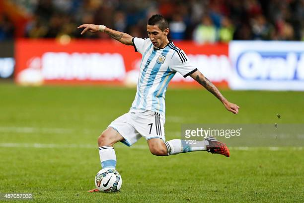 Angel Di Maria of Argentina kicks the ball during a match between Argentina and Brazil as part of 2014 Super Clasico at Beijing National Stadium on...