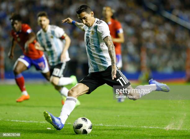 Angel Di Maria of Argentina kicks the ball during an international friendly match between Argentina and Haiti at Alberto J Armando Stadium on May 29...