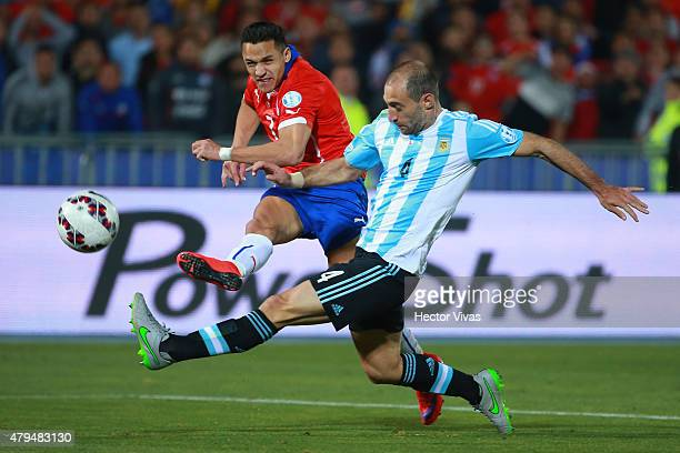 Angel di Maria of Argentina kicks the ball while Pablo Zabaleta of Argentina tries to stop him during the 2015 Copa America Chile Final match between...