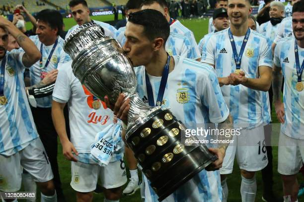 Angel Di Maria of Argentina kisses the trophy as he celebrates with teammates after winning the final of Copa America Brazil 2021 between Brazil and...