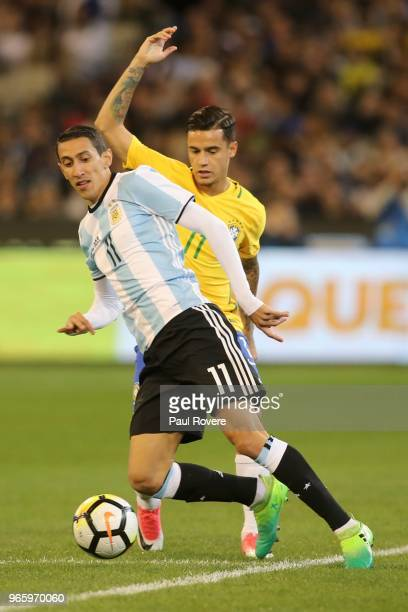 Angel Di Maria of Argentina leads Philippe Coutinho of Brazil to the ball during the Brazil Global Tour match between Brazil and Argentina at...