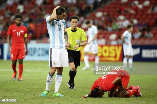 Angel Di Maria of Argentina looks on as Shakir Hamzah of Singapore lays injured during the International Test match between Argentina and Singapore...