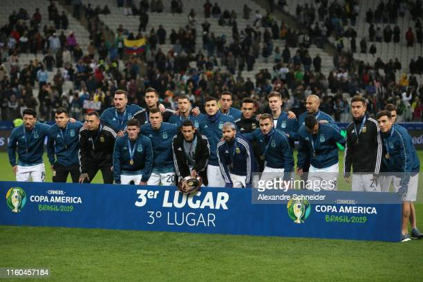 Angel Di Maria of Argentina poses with teammates after receiving the third place medal the Copa America Brazil 2019 Third Place match between...