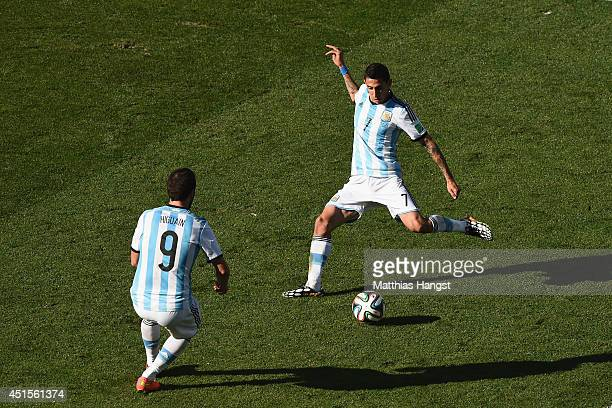 Angel di Maria of Argentina scores his team's first goal in extra time during the 2014 FIFA World Cup Brazil Round of 16 match between Argentina and...