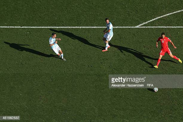 Angel di Maria of Argentina scores his team's first goal in extra time against Ricardo Rodriguez of Switzerland during the 2014 FIFA World Cup Brazil...
