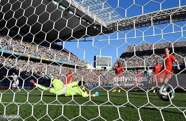 Angel di Maria of Argentina scores his team's first goal past Diego Benaglio of Switzerland during the 2014 FIFA World Cup Brazil Round of 16 match...